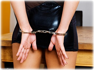 Bondage photo pic picture Kayla Louise barefoot, handcuffs, hogtie, leg irons, metal bondage, thumbcuffs, dress, ungagged