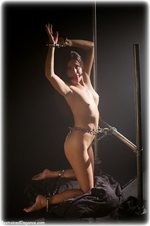 Bondage photo pic picture Kobe Lee ballgag, barefoot, handcuffs, brunette, leg irons, metal bondage, nude, crotch rope, dungeon