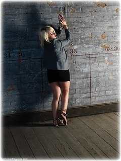 Bondage photo pic picture Millie Fenton ballgag, barefoot, handcuffs, blonde, shoes, business wear, leg irons, chains, melodrama, metal bondage, nude, dress, ungagged