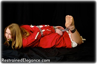 Bondage photo pic picture Missey hogtie, shackles, leg irons, chains, cloth gag, medieval, stockings, metal bondage, riding crop