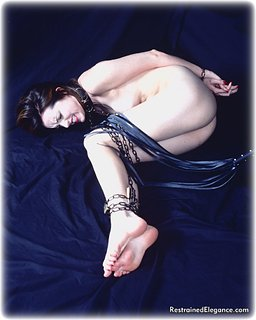 Bondage photo pic picture Molly Matthews barefoot, bastinado, leather bondage, chains, collar, nude, whipping