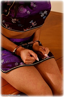 Bondage photo pic picture Natasha barefoot, handcuffs, hogtie, leg irons, chinese dress, metal bondage
