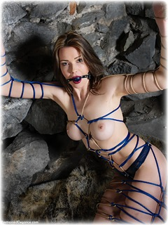 Bondage photo pic picture Nicky Phillips ballgag, rope bondage, barefoot, brunette, lingerie, dungeon, topless, ungagged