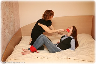 Bondage photo pic picture Ole Lykoile and Rozanka barefoot, girlgirl, blouse, hogtie, jeans, lesbian, tape gag, tickle, tickling