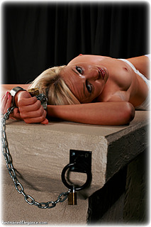 Bondage photo pic picture Paige Robbins handcuffs, shackles, leg irons, lingerie, stockings, metal bondage, collar