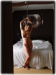 Bondage photo pic picture Penny Lee barefoot, bedroom, handcuffs, blonde, leg irons, chains, metal bondage, nude, drama, ungagged
