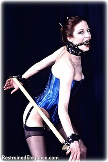 Bondage photo pic picture Rachel Paine ballgag, shoes, leather bondage, spreader bar, stockings, collar, corset