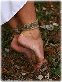 Bondage photo pic picture Ariel Anderssen rope bondage, barefoot, medieval, outdoor, gag