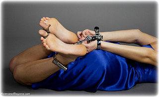 Bondage photo pic picture Riona ballgown, barefoot, handcuffs, satin, hogtie, silk, leg irons, metal bondage