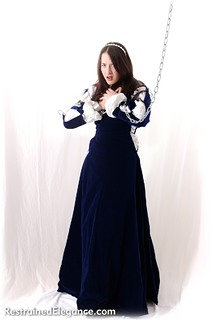 Bondage photo pic picture Rose Wood gown, historical, shackles, humiliation, brunette, chains, medieval, metal bondage, nude, ungagged