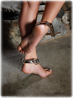 Bondage photo pic picture Roxy Mendez barefoot, handcuffs, brunette, leg irons, chains, metal bondage, nude, dungeon, ungagged