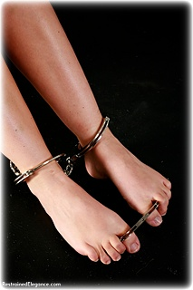 Bondage photo pic picture Sammie B barefoot, handcuffs, satin, humiliation, silk, leg irons, chains, metal bondage, topless
