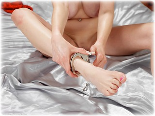 Bondage photo pic picture Sapphire barefoot, bedroom, handcuffs, hogtie, silk, leg irons, cloth gag, metal bondage, nude, thumbcuffs