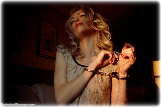 Bondage photo pic picture Sara W barefoot, bedroom, handcuffs, blonde, leg irons, lingerie, metal bondage, ungagged