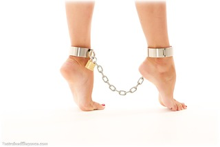 Bondage photo pic picture Scarlett barefoot, shackles, brunette, sm factory, leg irons, chains, metal bondage, collar, dress