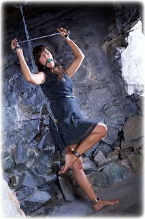 Bondage photo pic picture Scarlett ballgag, ballgown, barefoot, shackles, brunette, sm factory, leg irons, chains, spreader bar, metal bondage, dress, dungeon