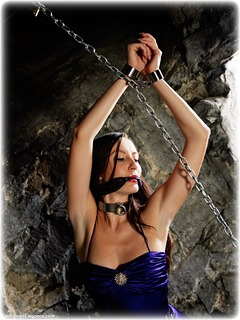 Bondage photo pic picture Sophia Smith ballgown, barefoot, satin, shackles, silk, brunette, sm factory, leg irons, cloth gag, melodrama, metal bondage, collar, dungeon, ungagged
