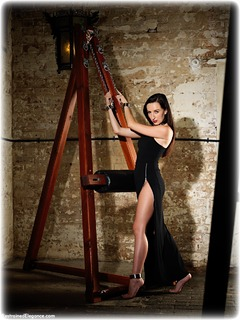 Bondage photo pic picture Sophia Smith ballgag, ballgown, barefoot, shackles, bondage pole, brunette, sm factory, leg irons, chains, metal bondage, collar, ungagged