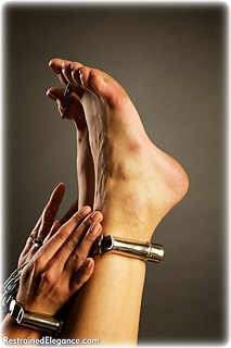 Bondage photo pic picture Tanya barefoot, handcuffs, leg irons, metal bondage, dress