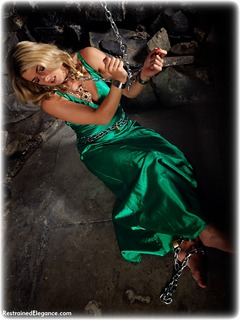 Bondage photo pic picture Tillie ballgown, barefoot, satin, blonde, shackles, silk, sm factory, leg irons, chains, metal bondage, collar, dungeon, ungagged