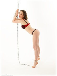 Bondage photo pic picture Tina Kay barefoot, handcuffs, brunette, leg irons, chains, lingerie, metal bondage, nude, ungagged