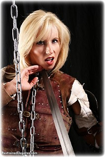 Bondage photo pic picture Tori Tyler barefoot, humiliation, shackles, boots, leather bondage, leg irons, chains, medieval, nude, outdoor, gag