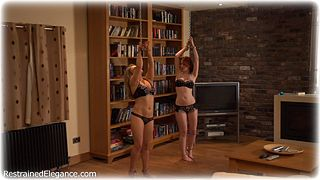 Bondage photo pic picture Amy Hunter and Fi Stevens barefoot, handcuffs, leg irons, slave training, chains, lingerie, metal bondage, corporal punishment, ungagged, riding crop