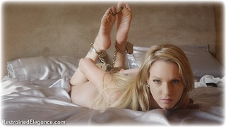 Bondage photo pic picture Angel Price barefoot, bedroom, handcuffs, blonde, self bondage, blouse, humiliation, skirt, business wear, slave training, leg irons, lingerie, metal bondage, nude, thumbcuffs, ungagged