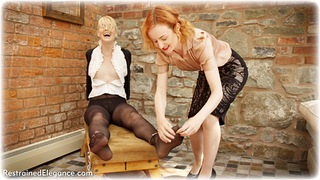 Bondage photo pic picture Anita deBauch and Ariel Anderssen girlgirl, handcuffs, blonde, blouse, shoes, humiliation, business wear, lesbian, chains, metal bondage, tickle, tickling, pantyhose