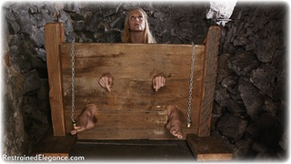 Bondage photo pic picture Ariel Anderssen barefoot, blonde, historical, shackles, leg irons, chains, medieval, stocks, metal bondage, collar, corporal punishment, dungeon, topless