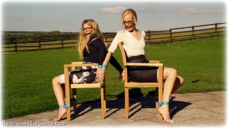 Bondage photo pic picture Penny Lee and Ariel Anderssen rope bondage, girlgirl, glasses, barefoot, bit gag, blonde, blouse, business wear, outdoor, pencil skirt