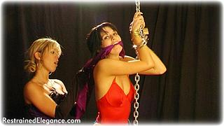 Bondage photo pic picture Myla and Belle girlgirl, handcuffs, humiliation, boots, chains, lesbian, cloth gag, metal bondage, uniform