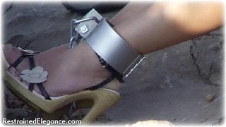 Bondage photo pic picture Belle shackles, shoes, leg irons, slave training, spanking, metal bondage, collar, corporal punishment, outdoor, riding crop