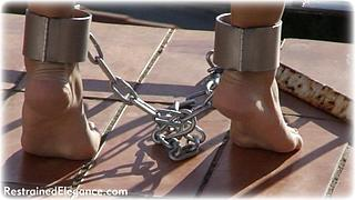 Bondage photo pic picture Belle barefoot, shackles, leg irons, chains, metal bondage, collar, outdoor