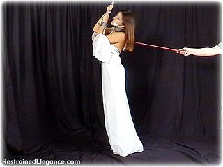 Bondage photo pic picture Charisma Cole ballgown, barefoot, shackles, leg irons, chains, cloth gag, metal bondage, collar, riding crop