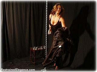 Bondage photo pic picture Christina Carter ballgown, barefoot, bit gag, self bondage, shackles, leg irons, chains, metal bondage, collar