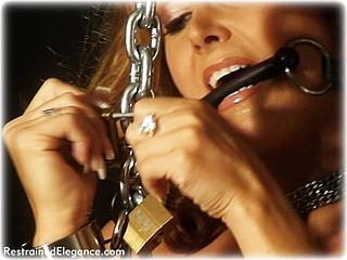 Bondage photo pic picture Christina Carter barefoot, bit gag, shackles, humiliation, leg irons, slave training, chains, spanking, metal bondage, collar, corporal punishment, nude, paddle