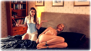 Bondage photo pic picture Ariel Anderssen and Chloe T ballgag, girlgirl, barefoot, bedroom, blonde, hogtie, shackles, sm factory, leg irons, lesbian, chinese dress, metal bondage, mockumentary, collar, comedy, corset, nude, ungagged, riding crop