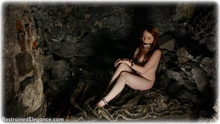 Bondage photo pic picture Jenny Smith ballgag, barefoot, satin, handcuffs, blouse, shoes, silk, skirt, business wear, leg irons, metal bondage, collar, nude, nude in metal, dungeon, redhead