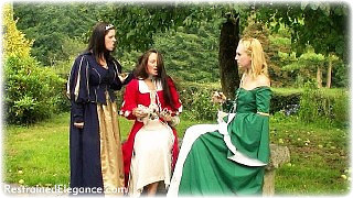 Bondage photo pic picture Ariel Anderssen, Sammie B and Temptress Kate ballgown, rope bondage, barefoot, bit gag, humiliation, leg irons, slave training, chains, medieval, metal bondage, collar, outdoor, topless, whipping