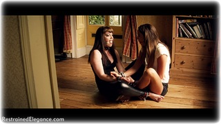 Bondage photo pic picture Natalia Forrest and Zoe Page ballgag, girlgirl, barefoot, blouse, humiliation, brunette, leather bondage, spreader bar