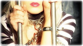 Bondage photo pic picture Paige Robbins barefoot, handcuffs, leg irons, metal bondage, topless, uniform
