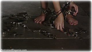 Bondage photo pic picture Penny Lee barefoot, handcuffs, self bondage, brunette, leg irons, metal bondage, nude, thumbcuffs, dungeon, ungagged