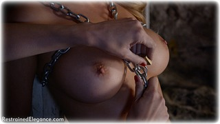 Bondage photo pic picture Penny Lee action, blonde, boots, chains, melodrama, metal bondage, dungeon, topless, ungagged