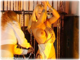 Bondage photo pic picture Alexandra and Petra Morgan girlgirl, humiliation, shackles, shoes, slave training, chains, lesbian, metal bondage, collar, topless, whipping