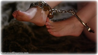 Bondage photo pic picture Zoe Page ballgag, barefoot, handcuffs, brunette, leg irons, chains, metal bondage, collar, nude, nude in metal, dungeon