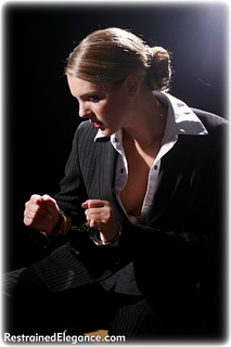 Bondage photo pic picture Zoe satin, handcuffs, blouse, brunette, business wear, metal bondage, ungagged